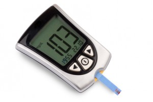 Glucometer isolated against a white background showing a good result